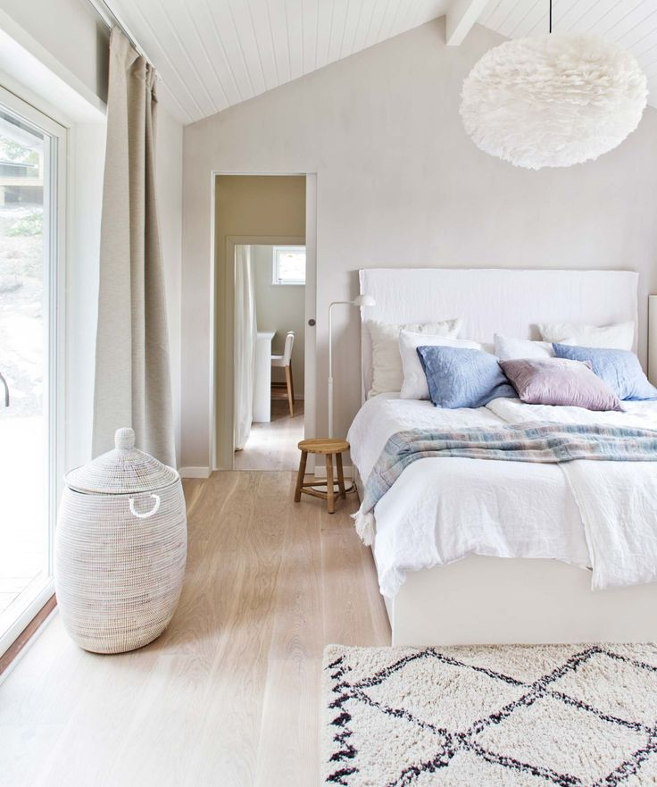 Light Colored Scandinavian Style Bedroom In A Summerhouse In Sweden