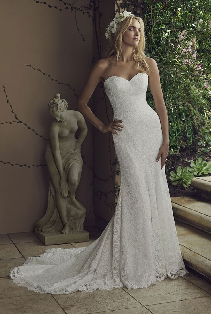 Casablanca Bridal - Water Lily. Water Lilys simple and graceful fit-n-flare silhouette is crafted with a deeply romantic lace overlay atop Duchess Satin lining, from the strapless sweetheart neckline down to the delicate train. A sprinkling of demure buttons down the back of the gown completes this classic gown.