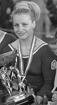 Věra Čáslavská (Czech  3 May 1942 − 30 August 2016) was a Czechoslovakian and Czechian artistic gymnast. Attractive, cheerful and possessing impressive stage presence, she was popular with the general public and won a total of 22 international titles between 1959 and 1968 including seven Olympic gold medals, four World titles and eleven European championships. She was diagnosed with pancreatic cancer in 2015. She in a Prague hospital August 30 2016 from PANCREATIC CANCER at the age of 74.
