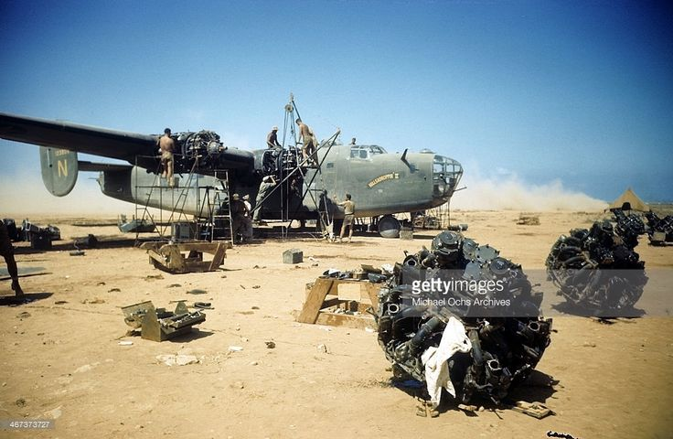 A view as crew of the 44th Bombardment Group work on a B24 Liberator at the U.S Air Force Base in Benghazi, Libya.