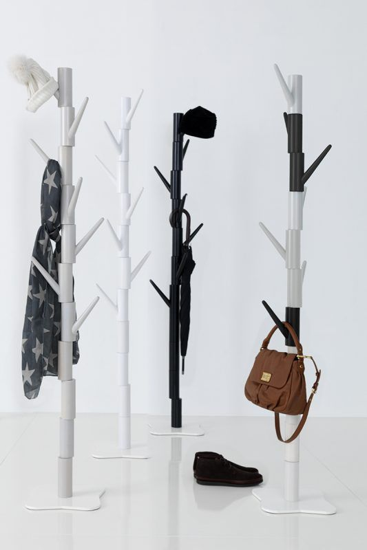Klods Hans is a free standing coat rack with rotatable hanging bars in solid birch. The design stands out in a pleasing way and tempt to creative use. Scandinavian design. Made in Sweden. Design - Tom Stepp