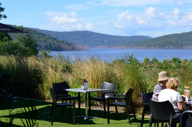 People sitting in View Cafe overlooking Hinze Dam