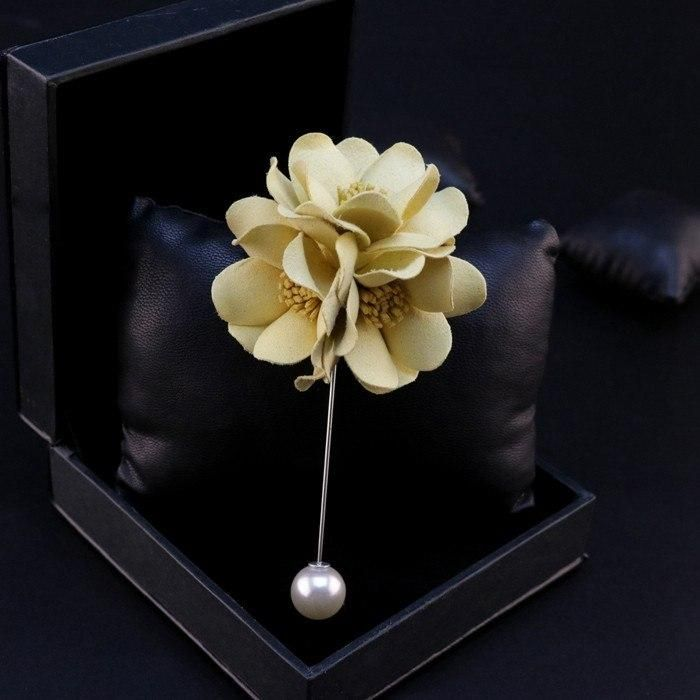 Classy Yellow Lapel Flower: The rose flower of the lapel pin is made with a classy shade of yellow with the stigmas that are placed in the center, made in dark yellow fabric.  bowselectie.com