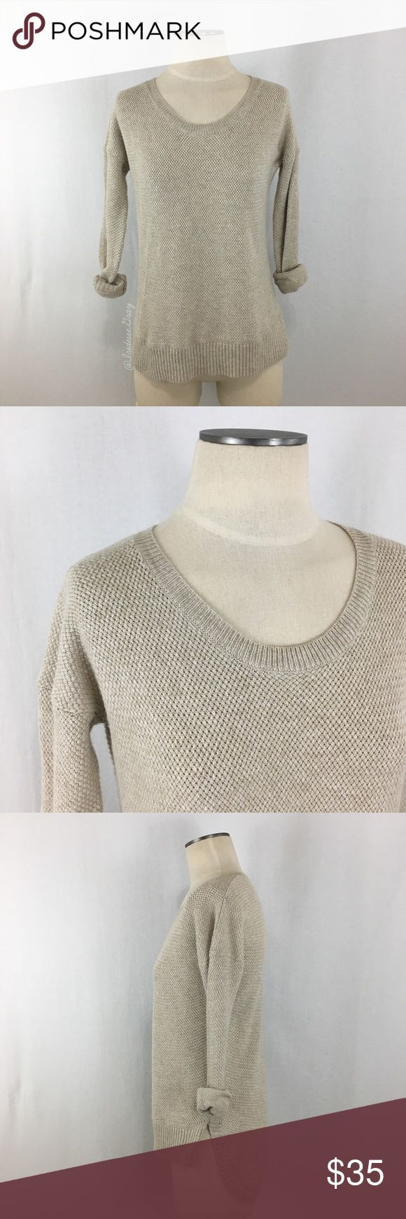 """Madewell- Oatmeal Basketweave Hi-Low Sweater SZ XS Madewell- Oatmeal Basketweave Hi-Low Sweater Size XS. Made of 62% Cotton, 20% Viscose, and 18% Nylon. Long sleeved style. Hem is straight in the front, longer and curved in the back. Wrists and hem have a rib knit trim. Great preloved condition, there is a light perfume scent to it. Shoulder-bottom measures about 22.5"""" long in the front, 27"""" in the back. Armpit-armpit measures about 19"""" across laid flat. (G). Madewell Sweaters Crew & Scoop…"""