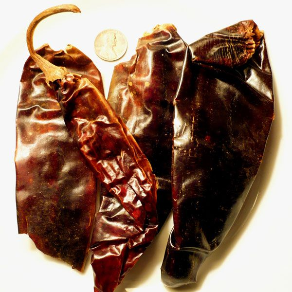 Guajillo Guajillo Chili Pepper 2,500 - 5,000 Scoville Units. Capsicum annuum. A guajillo chili is a variety of chili pepper produced by drying the Mirasol Chili, and which is widely used in the cuisine of Mexico. The guajillo chili's thin, deep red flesh has a green tea flavor with berry overtones. Its fruits are large and mild in flavor, with only a small amount of heat.