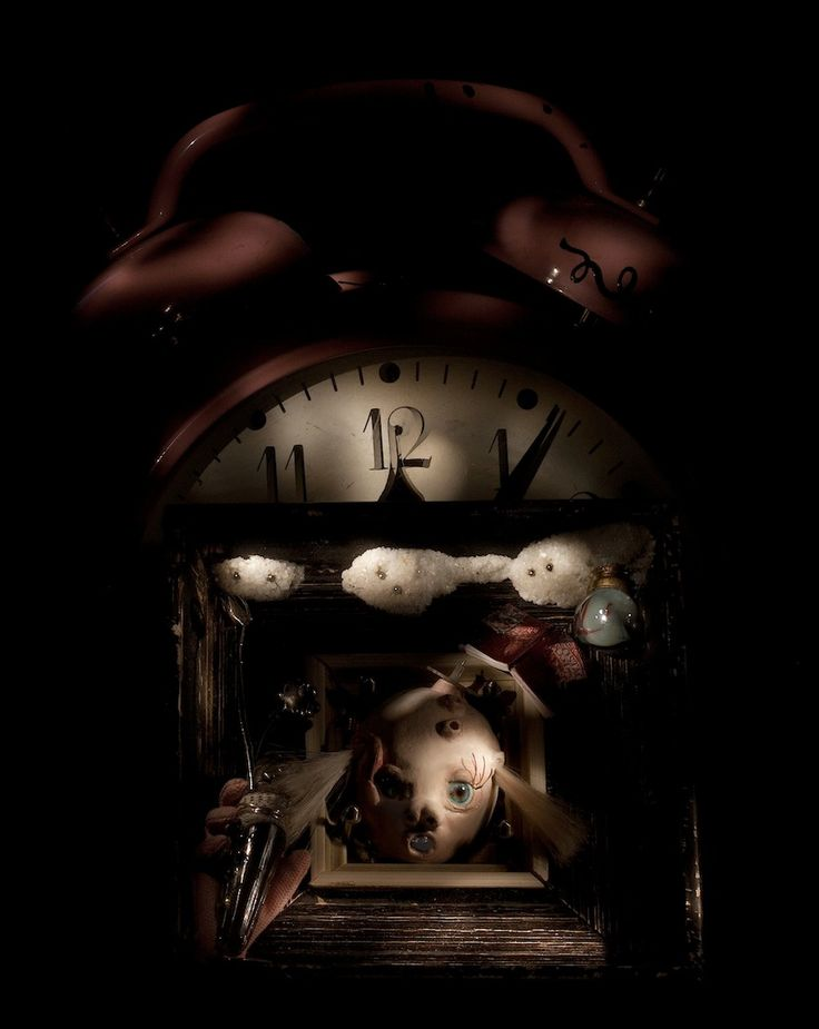 Illusion of time (Mona Mae) - OOAK artwork captured in still life torchlight photo - work itself uses mix of materials - air dry clay, glass eyes, fabric for dolls, metal parts made by artist - background as glass, fusing, metal work, soldered pieces, etc., etc.