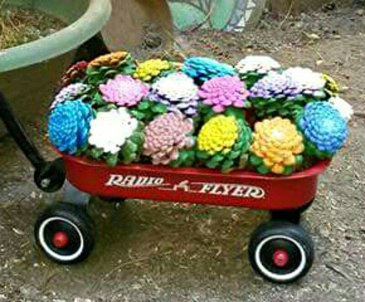 Love this!  Pine cones, painted to look like zinnias, in a miniature wagon!