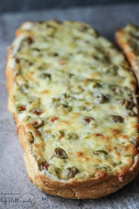 """One lazy Saturday morning, I was enjoying my coffee and watching The Pioneer Woman, and my life was forever changed by this Jalapeño Olive Cheese Bread. I almost missed it too because I stepped into the kitchen. But luckily when I came back, my husband said, """"You have to rewind it."""""""