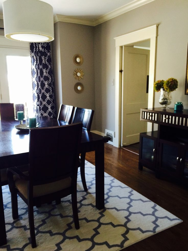 Dining Room With Target Lattice Rug And Brushed Gold Mirrors Indigo Curtains From Home Goods