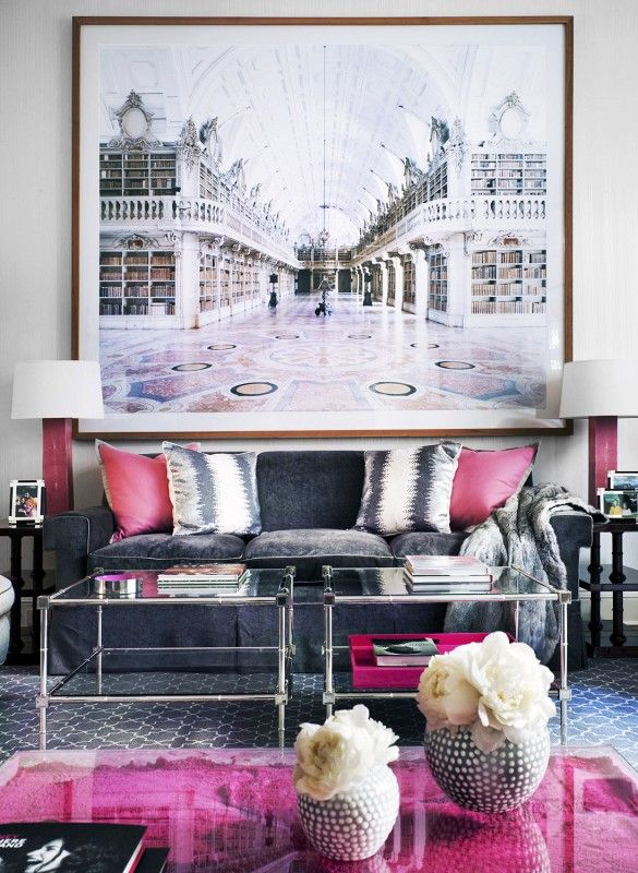 Oversized photograph with gray sofa and pops of pink.