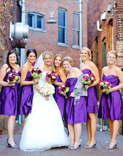 Love the purple bridesmaid dresses and the flowers.