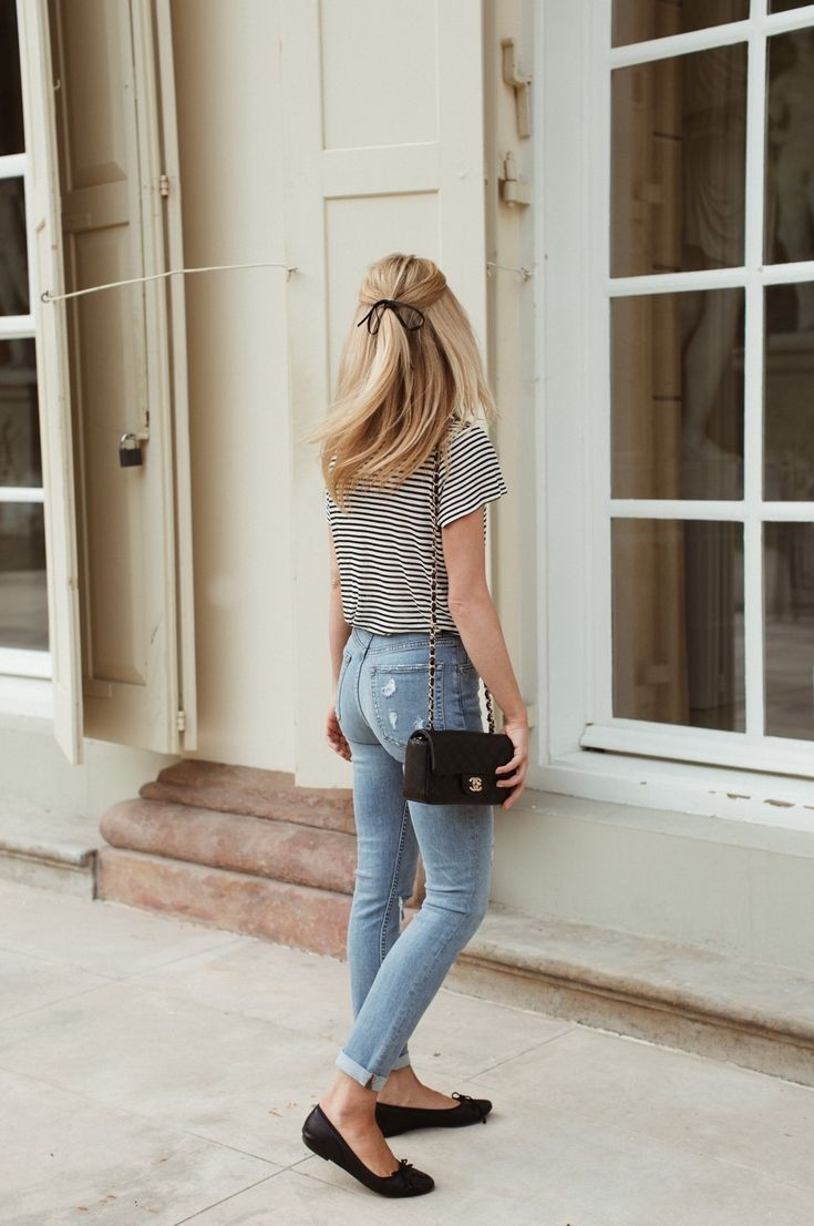Simple look with a classic striped tee and distressed jeans, simple flats and a ribbon hair tie