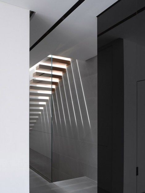 Light falling through an open staircase inside the Herzelia Pituah House by Pitsou Kedem.