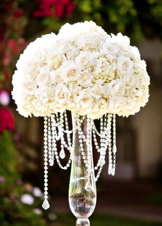 Photographer: True Photography; Stunning white rose wedding reception centerpiece;