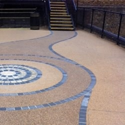 Resin bound and resin bonded paving can be used to create stylish courtyards an footpaths for commercial applications.