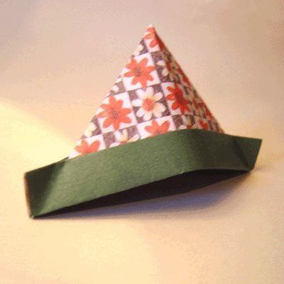 This is really easy! If it's made out of newspaper or maybe even a long sheet of paper, it might fit the kids to wear