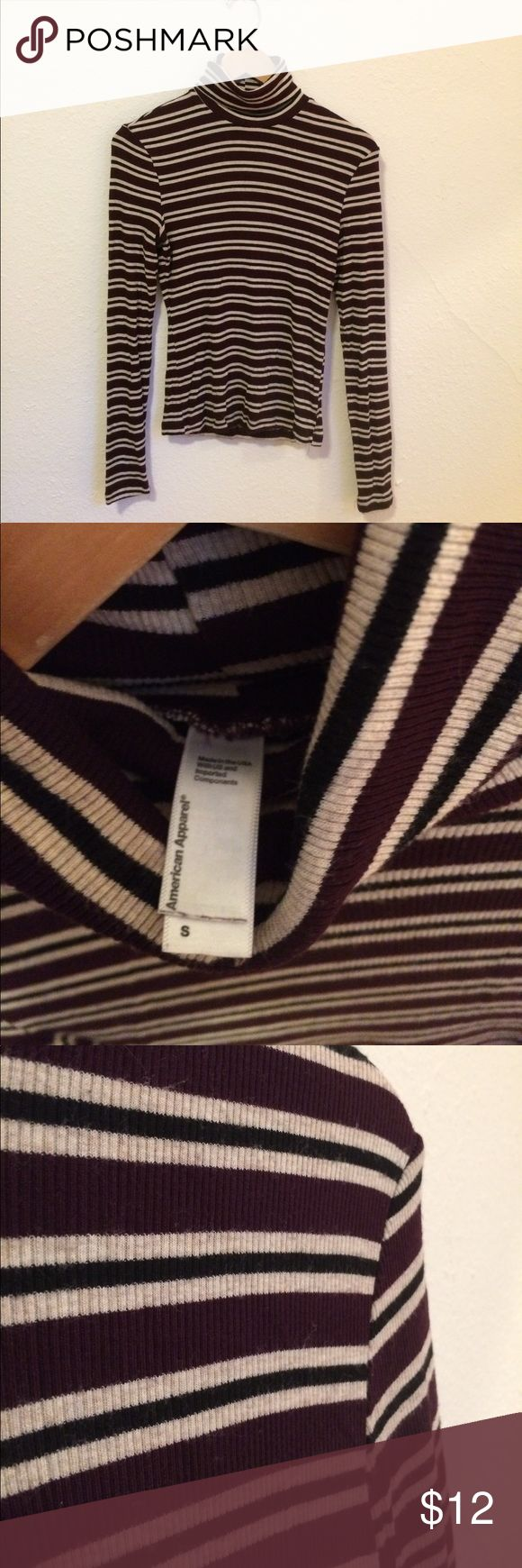 American Apparel Rib Turtleneck American Apparel ribbed turtleneck long sleeve shirt with a striped pattern. It is black, cream and the color eggplant which is a dark purple red color. Great with a cute skirt and boots! American Apparel Tops