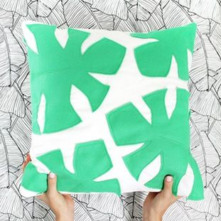 With just a few pieces of felt, a pair of scissors and a little fabric glue you can create a comfy pillow adorned with tropical palm fronds in minutes. Click through for the full tutorial.