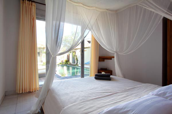 The romantic #bedroom has a nice #pool view.