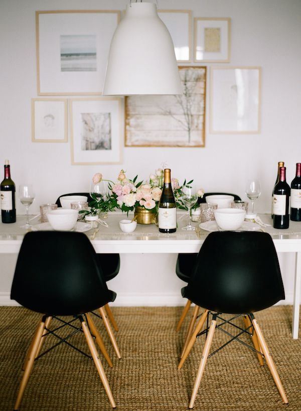 black eiffel chairs , white table , white art, white walls, natural rug, love.