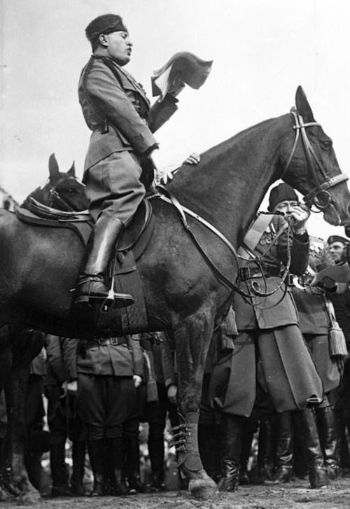 Il Duce on a horse.