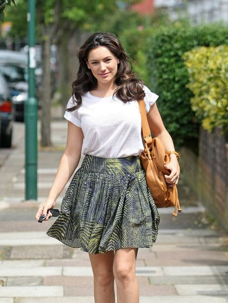 Kelly Brook T-Shirt - Kelly glams up a classic white tee by rolling the cuffs in totally retro way.