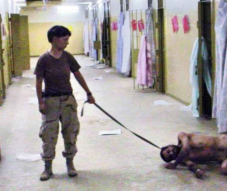 Abu Ghraib Prison, 2004 | The explosive images inside the Abu Ghraib prison in Baghdad, Iraq, caused international controversy. Released at the height of the Iraq War, the images brought to light the torture and humiliation that Iraqi prisoners withstood at the hands of the US Army personnel. This particular one shows Pfc. Lynndie England holding a leash attached to a detainee in late 2003. | Photo and text via: all-thats-interesting.tumblr.com |