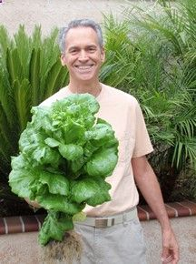 The Happy Portable Farmer, Colle Davis (aka The Fish Whisperer), Inventor, with a single head of lettuce from one of his own Portable Farms Aquaponics Systems that was grown in only 40 days. This is an unretouched photo.