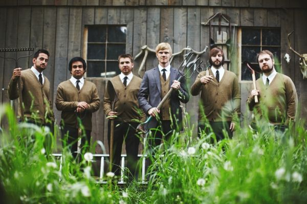 I love this, even though they look somewhat dark and vicious, great woodsy groomsmen picture