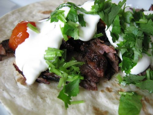 Grilled chuck steak burritos with roasted cherry tomatoes, sour cream and cilantro #BBQ #recipe #food