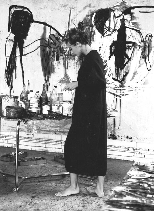 White wall, drawings, paint, long black dress, bare feet, art