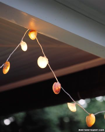 """What a cleaver way to add a """"theme"""" to outdoor decor.  Just take small shells and glue them to a string of white lights.  Results: muted light with plenty of style."""