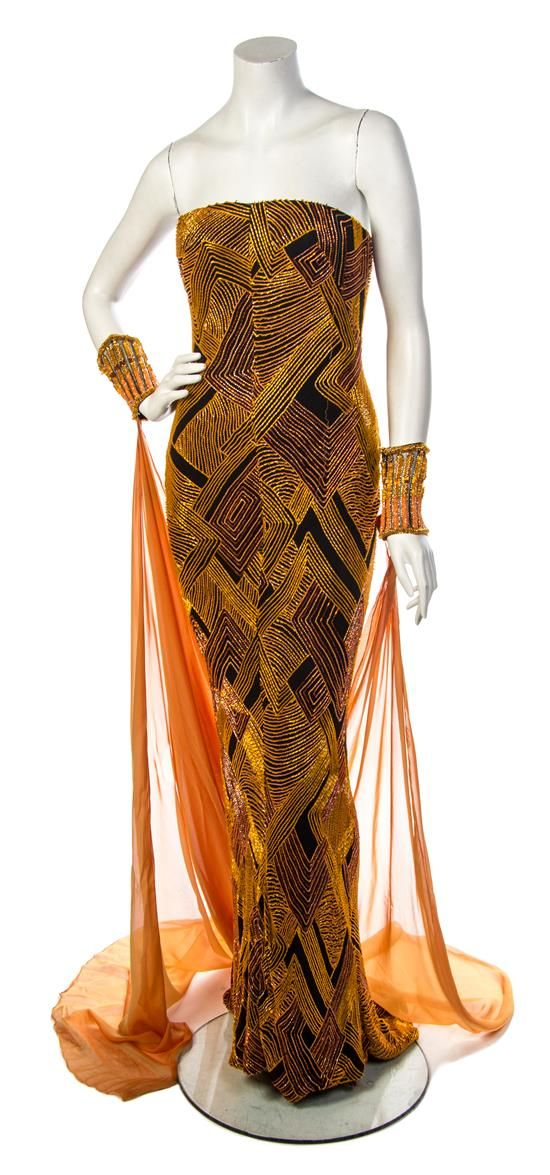 A Bob Mackie Goldtone Beaded Strapless Evening Ensemble Goldtone Beaded Strapless Evening Ensemble, comprised of a gold, orange and brown geometric print gown, together with a matching beaded headdress and a pair of arm bands.