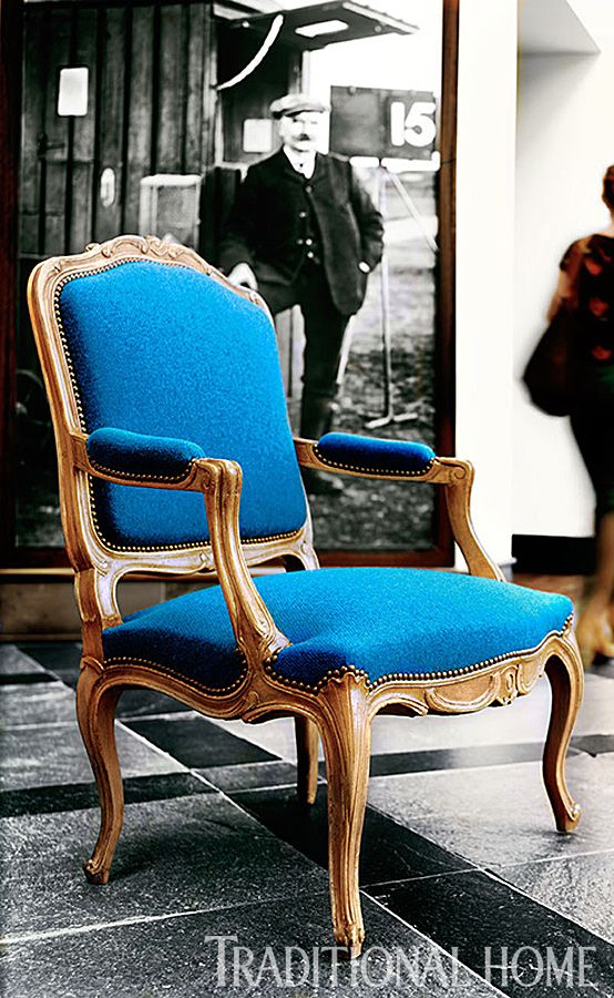 """Furniture in St. Andrews:  Honey tones of Taillardat's """"Chevigny"""" chair frame complement blue """"Featherweight"""" tweed from Carloway Mill.  Photo: Dominic Blackmore   Traditional Home"""