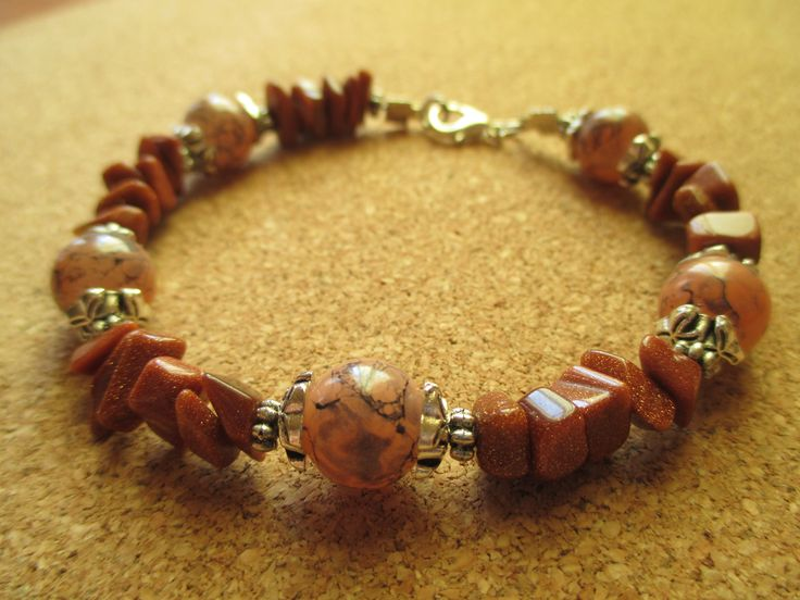 Colored glass beads and goldstone bracelet. Perfect to achieve goals, stay calm and generate energy.