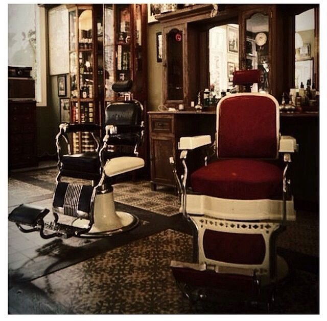 Old school barbers, with black and white chair on the left and red and white…