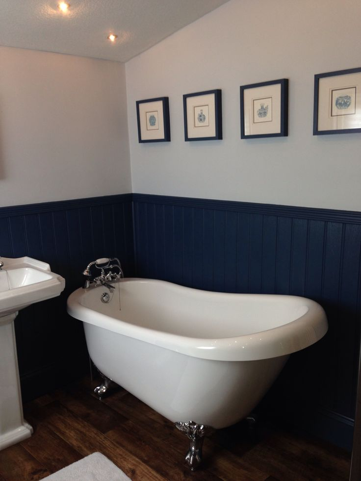 Little Greene's Hicks blue woodwork and tongue and groove in victorian bathroom, accessorised with chinoiserie art & blue white walls.