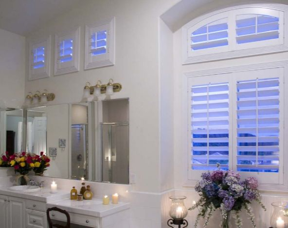 These Custom Thermalite Plantation Shutters Add Elegance While Enhancing  Privacy In This Master Bedroom.