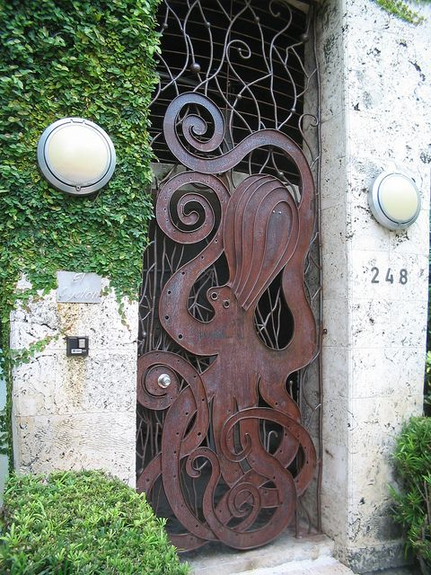 Miami Art Deco gate with octopus sculpture,  by BEV Norton     This is 248 Washington St. El Cyclon Tower Lofts, real high end rental space not on a beach, built in 1998 .      via Wil Cunningham