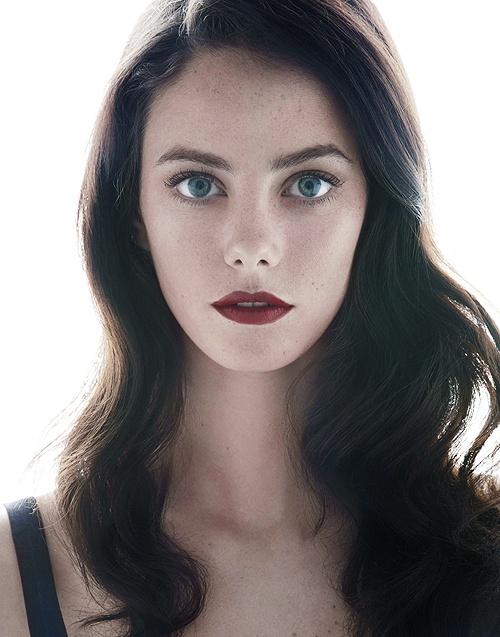 Black hair, blue eyes.