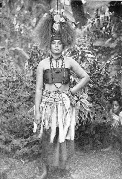 Samoan taupou wearing the 'tuiga' ornamented head-dress made of human hair.