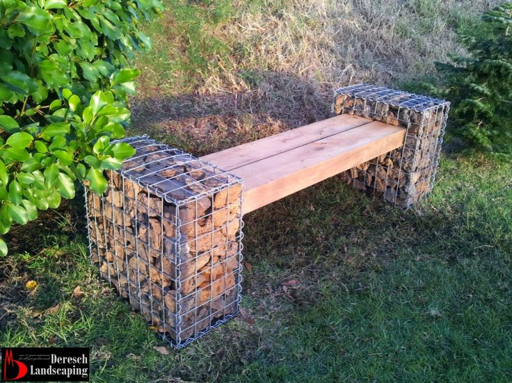 garden bench made of gabions and macrocarpa sleepers