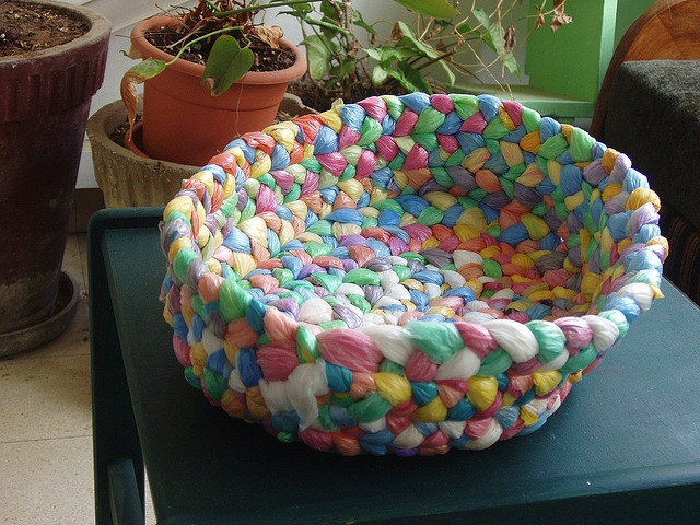 plastic bags braided into a basket