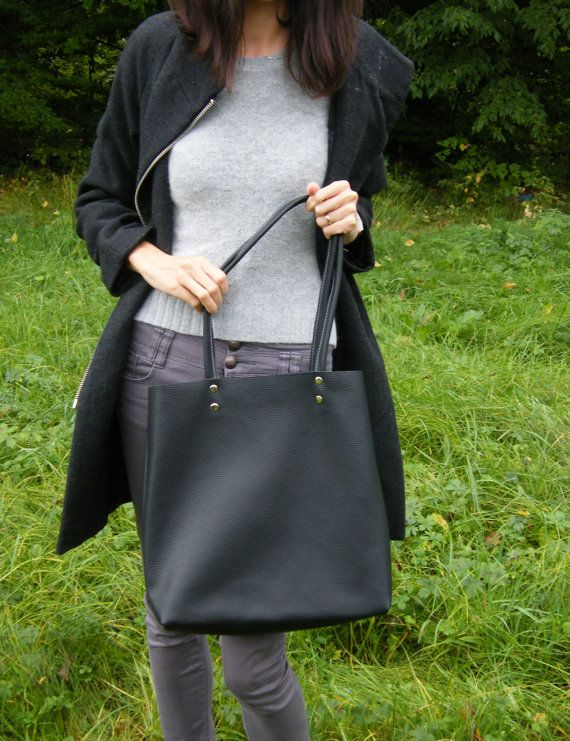 You can find more pictures here https://www.facebook.com/MrArtigiano/  This minimalis leather tote with wool felt, represents our focus on