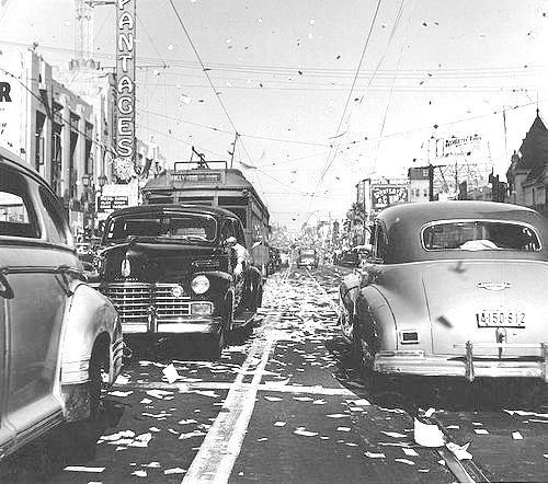I have a number of dates ready to plug into that time machine and this day would be one of them. In this photo, we're seeing VJ Day – the day victory over Japan was declared, thus ending WWII. It was August 14th, 1945, and this was taken just east of Hollywood and Vine. We can see the vertical neon sign of the Pantages Theater and the Hollywood Boulevard streetcar as it inches westward. I suspect it took a very, very long time to get anywhere on the boulevard that day.