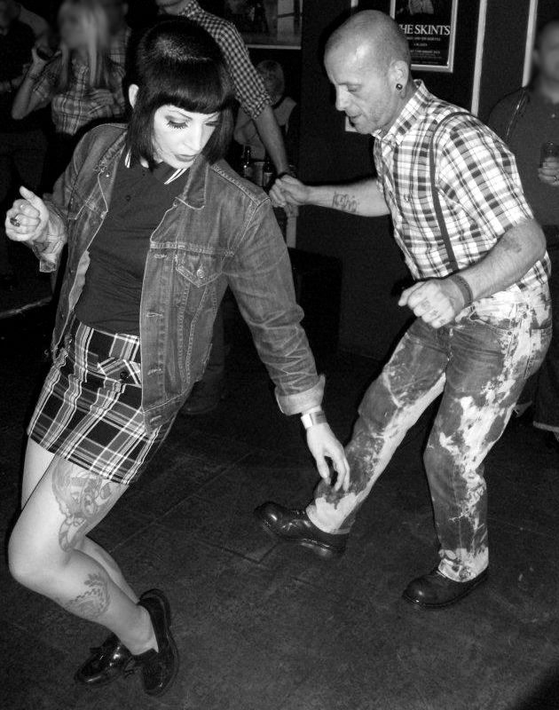 Skinhead boy & girl dancing