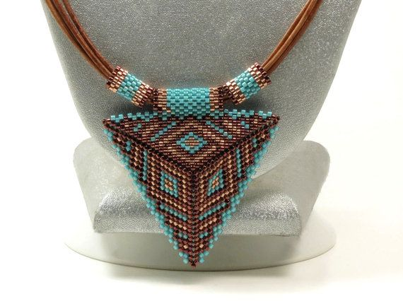 This listing is for the necklace ONLY. The earrings in the last photo can be found here: https://www.etsy.com/listing/293006331/peyote-triangle-earrings-copper-and?ref=shop_home_active_1  A very unique leather necklace that features a beautiful peyote stitched triangle pendant. The triangle is two dimensional. It puffs up slightly in the center. Its been beaded with Miyuki delicas using one of my favorite color combinations...dark copper, bright copper, and turquoise. The triangle is 2 x 2…