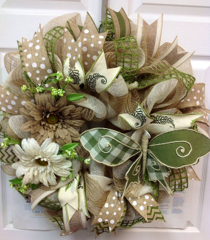 Burlap wreath with Burlap ribbons and butterfly. Check out my FB page for more designs. Ms. Kay's a-DOORable Designs.