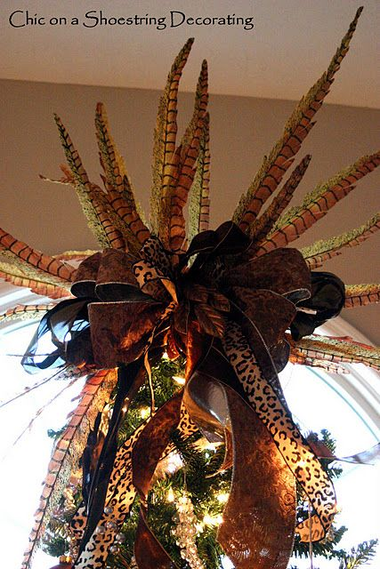 I love this Christmas Treetopper with Leopard ribbon and pheasant feathers. (both can be found at Michael's)