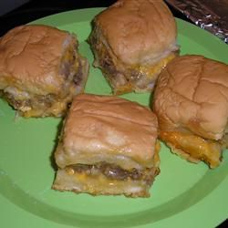 Game Day Sliders: 1 lb ground beef,  1 block (8 oz) cheddar cheese,  1 pkg  Lipton Onion Soup Mix,  1 T mayonnaise,  1/4 t garlic power,  1 pkg (12 count) mini hamburger/slider buns.